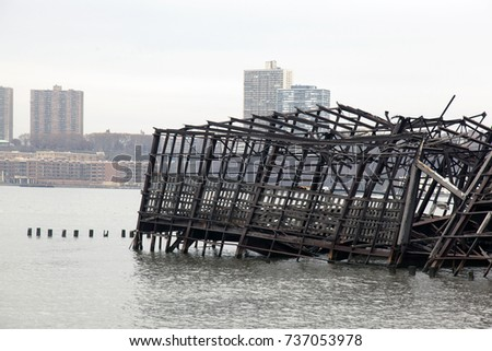 Collapsed metal built structure of a pier in the river #737053978