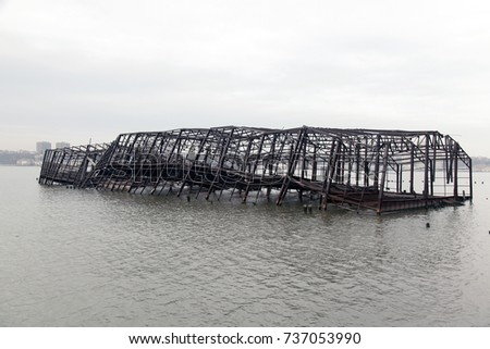 Collapsed metal built structure of a pier in the river #737053990