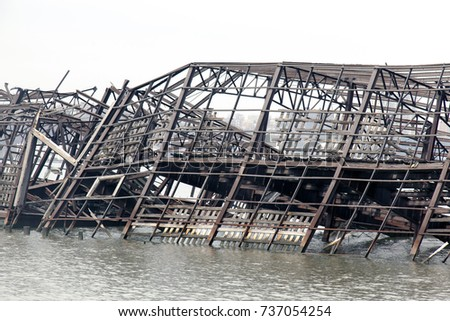 Collapsed metal built structure of a pier in the river #737054254