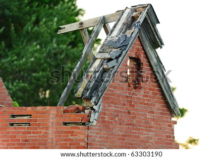 Collapsed roof on an old brick structure - stock photo