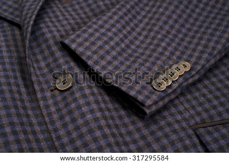 Collar detail and empty tag of dark blue coat