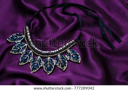 collar necklace with beads isolated on silk #777289042