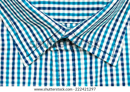 Collar of a blue checked casual shirt
