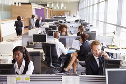 Colleagues busy working at desks in an open plan office