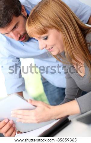 Colleagues in office with electronic tablet