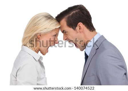 Colleagues quarreling head against head on white background