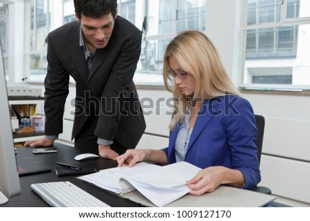 Colleagues reviewing a business plan - Shutterstock ID 1009127170