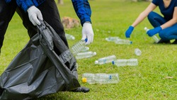 Collect plastic bottles on the grass in the park clean up the woods help environmental charity waste collection ideas