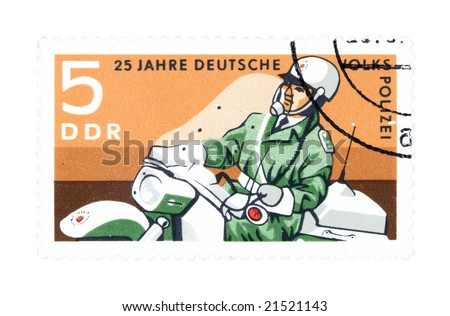 Collectible stamp from East Germany. Stamp with police officer on motorcycle.