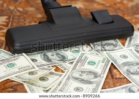 Collecting by a vacuum cleaner from a floor of money