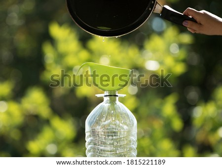 Collection and recycling of used household edible oil. Stockfoto ©