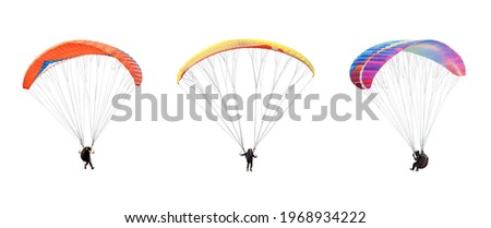 collection Bright colorful parachute on white background, isolated. Concept of extreme sport, taking adventure challenge. Stock fotó ©