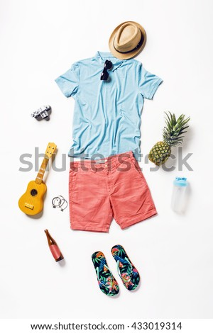 collection collage of men\'s clothing and accessories. Overhead of essentials young man on vacation. Summer outfit of casual man, camera, sunglasses.