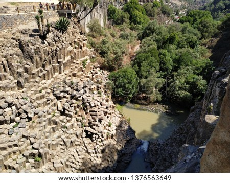 Collection of aerial photos of a canyon with rock walls in the form of prisms with a river below fed by 2 waterfalls and trees near