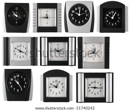 collection of alarm clocks on white