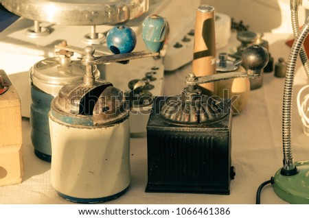 collection of antique objects of various kinds at a flea market. #1066461386