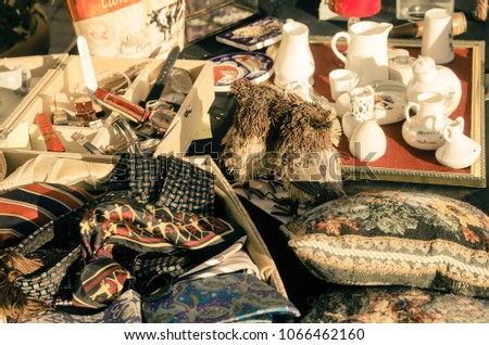collection of antique objects of various kinds at a flea market. #1066462160
