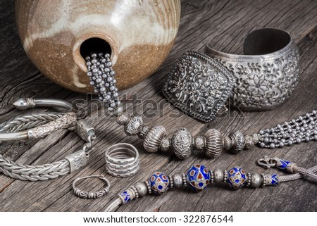 Collection of antique traditional silver jewelry on old wood