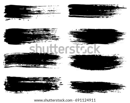 Collection of artistic grungy black paint hand made creative brush stroke set isolated on white background. A group of abstract grunge sketches for design education or graphic art decoration #691124911