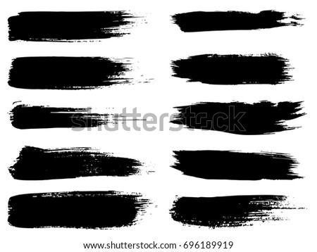 Collection of artistic grungy black paint hand made creative brush stroke set isolated on white background. A group of abstract grunge sketches for design education or graphic art decoration #696189919