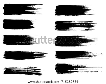 Collection of artistic grungy black paint hand made creative brush stroke set isolated on white background. A group of abstract grunge sketches for design education or graphic art decoration #715387354