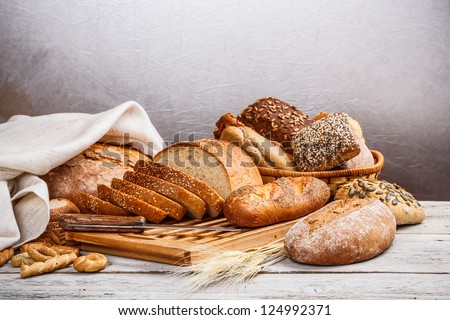 Collection of baked bread on wooden background