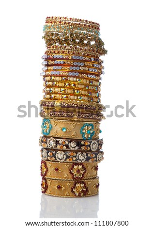 collection of bangle placed one top other