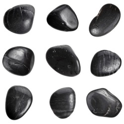 Collection of black SPA stones close up macro set isolated on white background