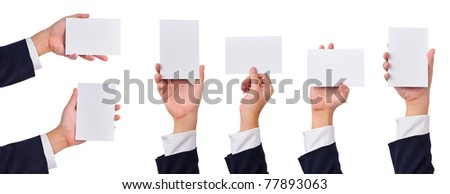 Collection of blank cards in business man's hands isolated on white.