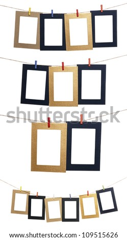 Collection of blank photo frames hanging by clothespins on a rope. You can put your image in the frame