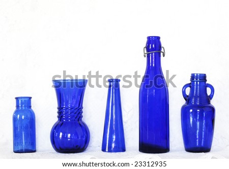 collection of blue glass bottles - stock photo