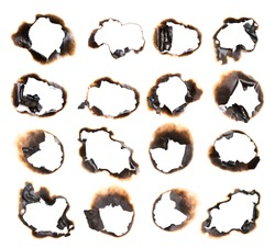 Collection of burnt holes in a piece of paper isolated on white background