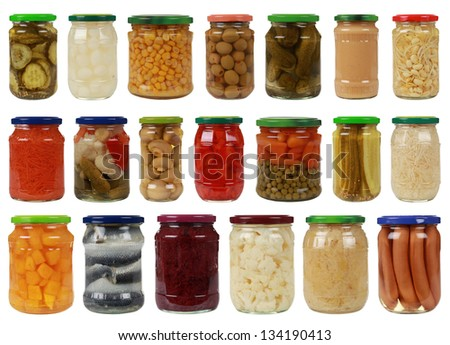 Collection of canned vegetables in glass jars, isolated on white