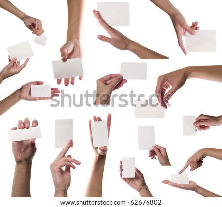 Collection of card blanks in a hand on white background