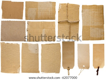 collection of cardboard corrugated paper sheets and tags with strings
