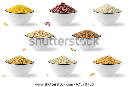 Collection of cereals and legumes in bowls isolated on white background