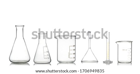 Collection of chemical glassware in laboratory isolated on white background.