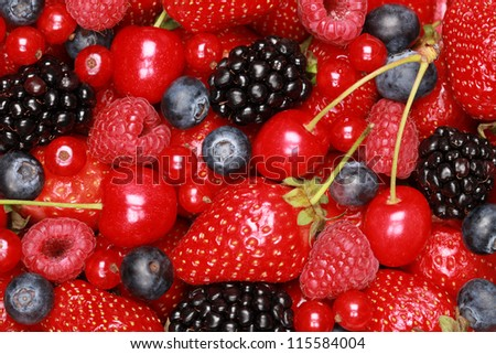 Collection of cherries, strawberries, bilberries, red currants, raspberries and blackberries