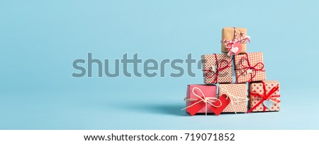 Collection of Christmas present boxes on a light blue background #719071852
