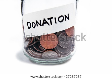 Collection of coins in a jar labeled for donation