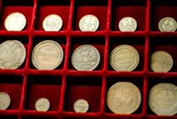 Collection of coins on  red velvet background. Money. Old antique coins from  time of tsarist Russia.