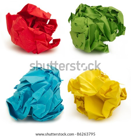 collection of colorful crumpled papers over white background