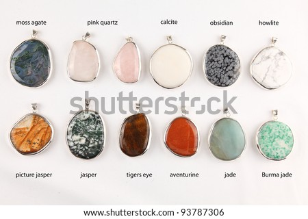 Collection of colorful different gemstone pendants with sterling silver
