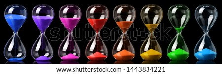 Collection of colorful hourglasses showing the passage of time Photo stock ©