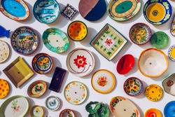 Collection of colorful Portuguese ceramic pottery, local craft products from Portugal. Ceramic plates display in Portugal. Colorful of vintage ceramic plates in Sagres, Portugal.