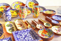 Collection of colorful Portuguese ceramic pottery, local craft products made in Portugal