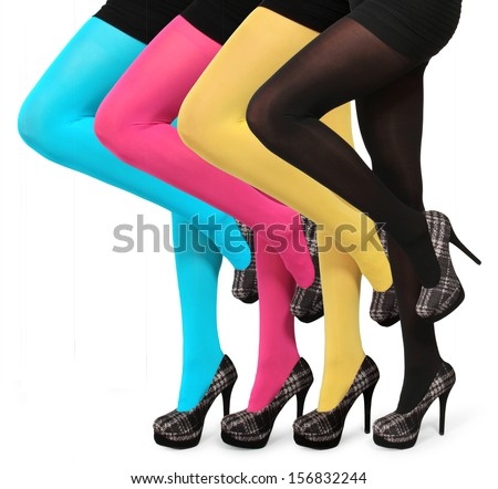 collection of colorful stockings on sexy woman legs isolated on white - stock photo