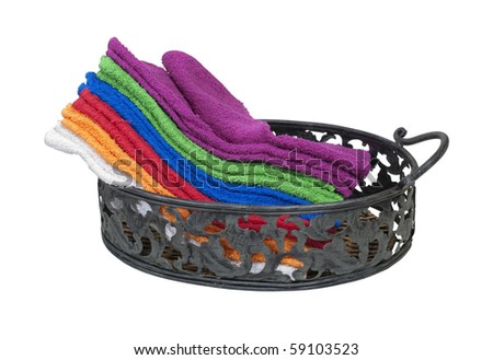 Collection of colorful towels for everyday use in a serving tray - path included