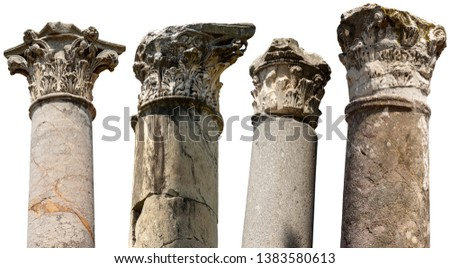 Collection of columns with capitals in Corinthian style isolated on white background. Ostia Antica, Roman colony founded in the 7th century BC. Rome, UNESCO world heritage site, Italy, Latium, Europe