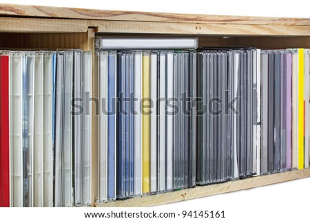 Collection of Compact Discs (CDs) in a shelf